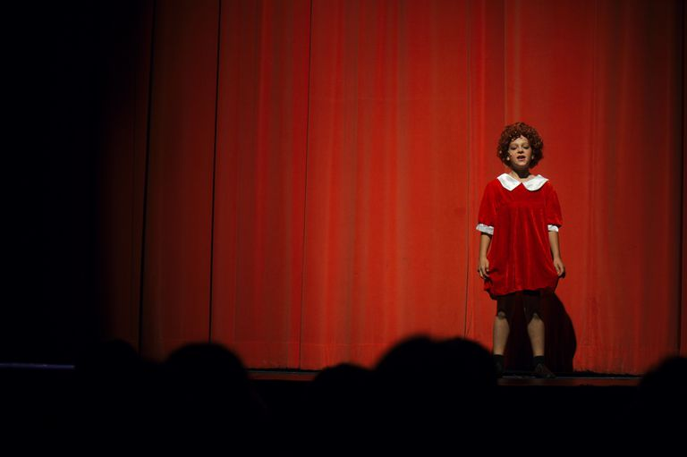 "Little Orphan Annie sings ""Tomorrow"" on stage"