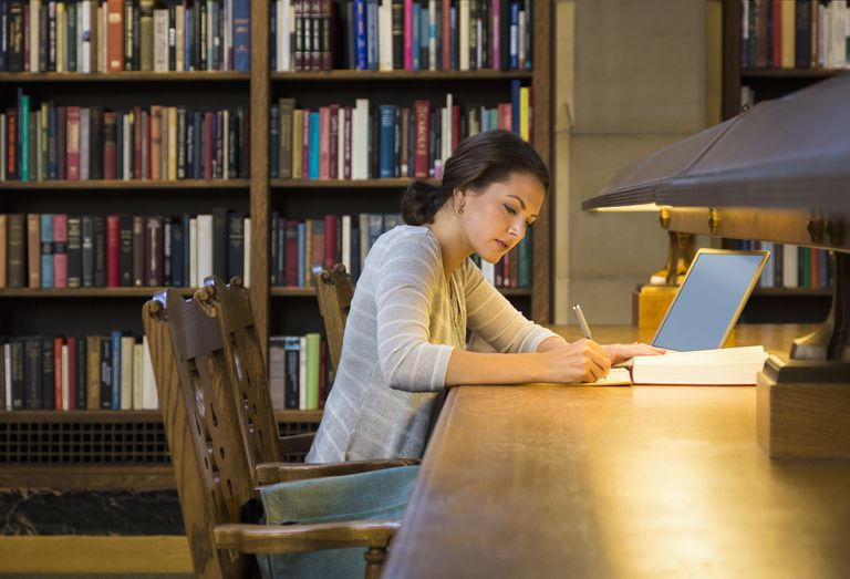 University student studying in library