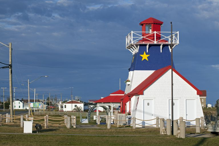 Grande-Anse Lighthouse in New Brunswick, Canada, is painted with the colors and symbols of the Acadian flag.