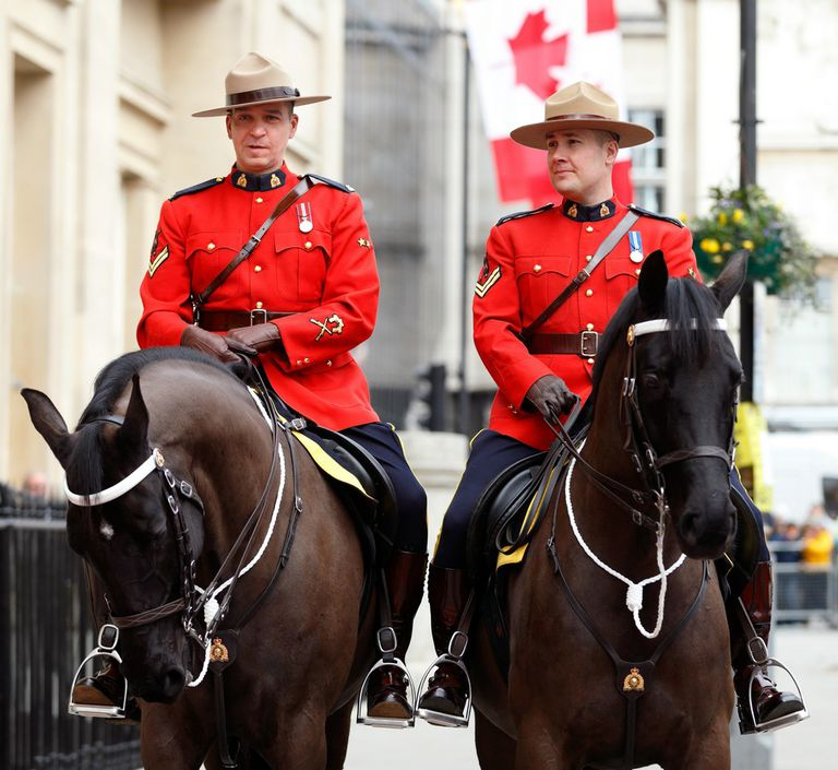 Two Canadian police officers on horses