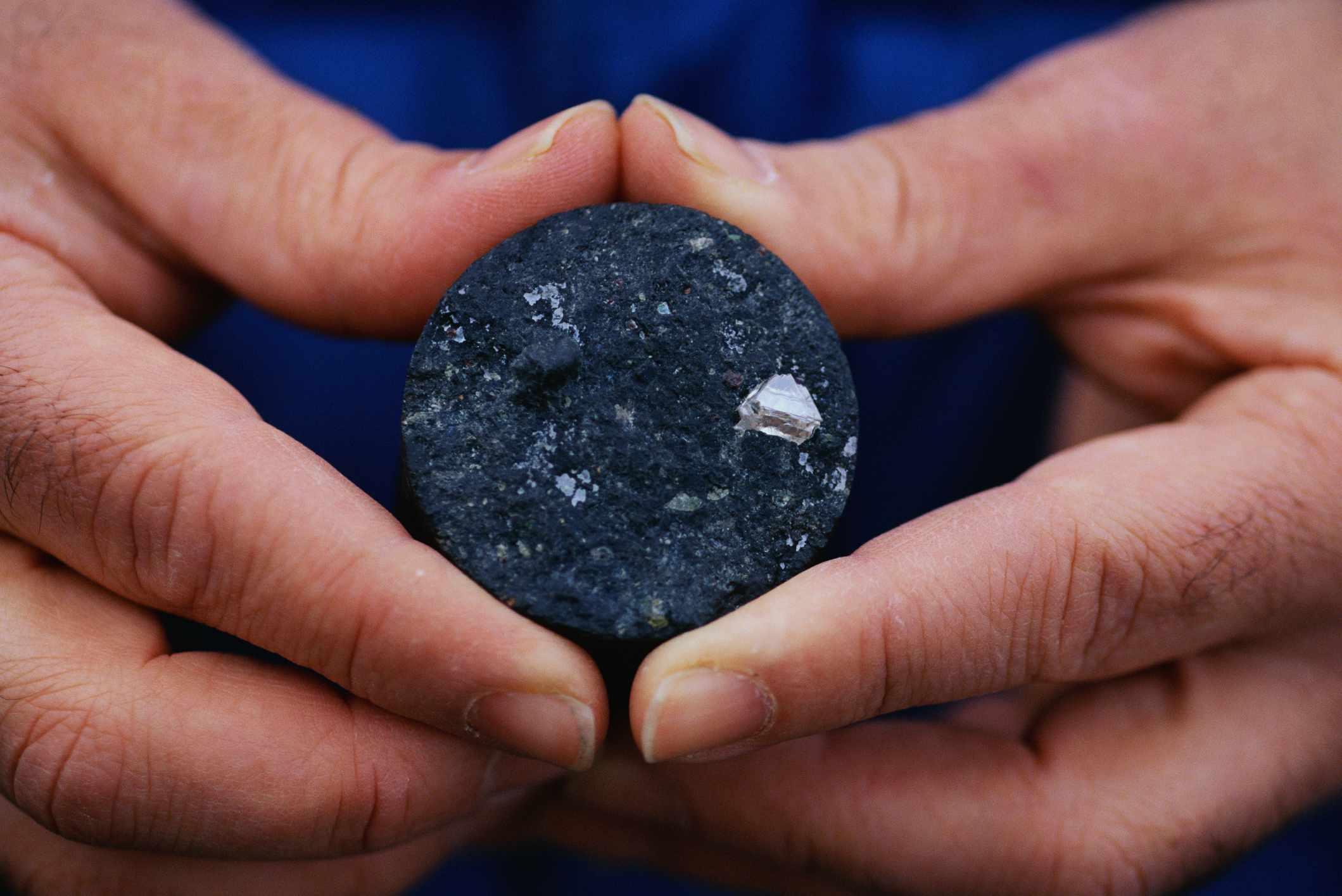 Holding a 1.75-carat diamond