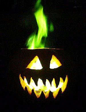 This Halloween jack-o-lantern is filled with green fire.