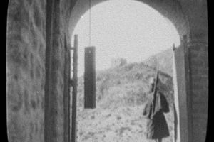 An Indian sepoy stands sentry duty at a fort on Khyber Pass in 1895.