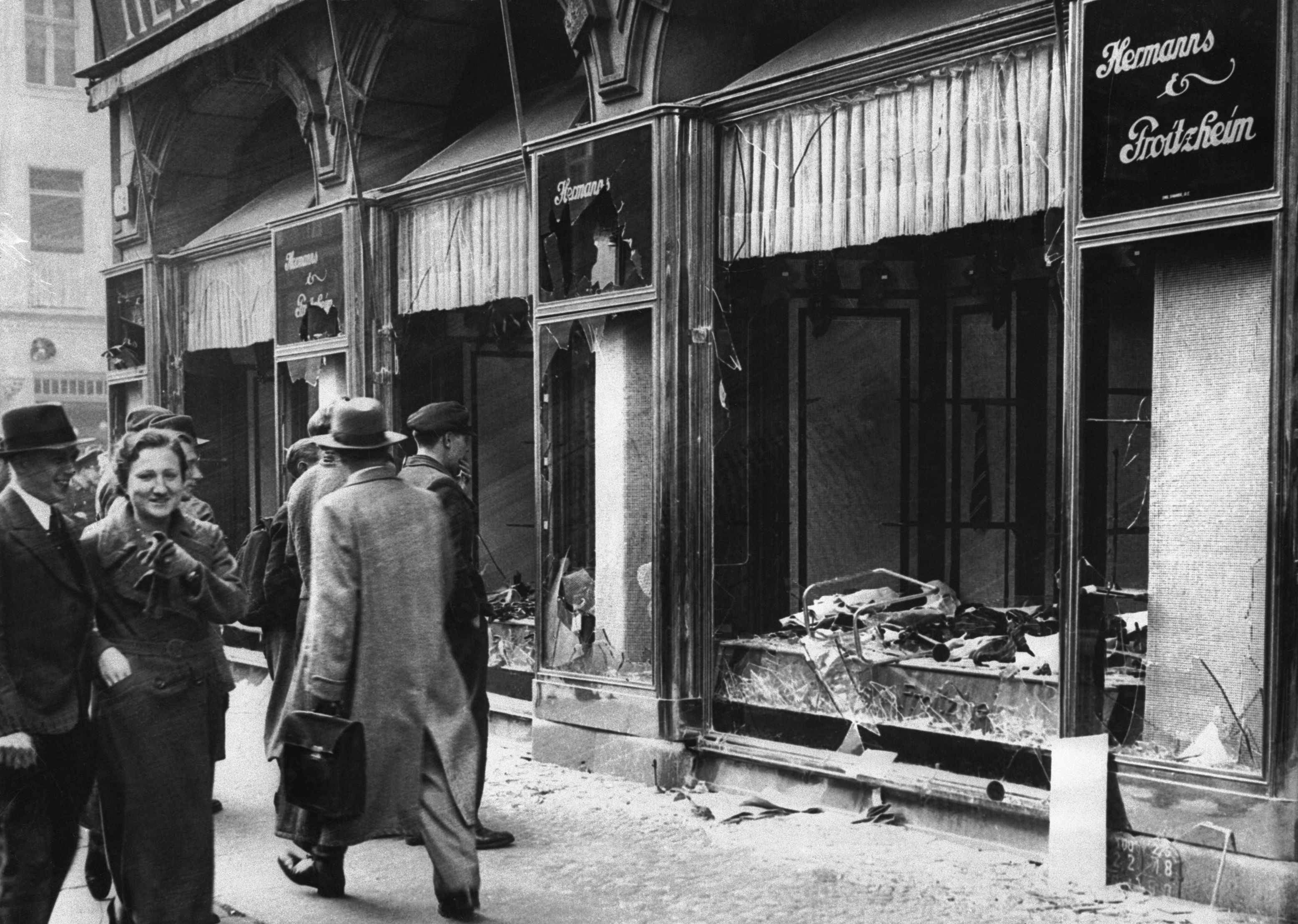 Damaged Jewish-owned storefront in Berlin after the Kristallnacht riot.