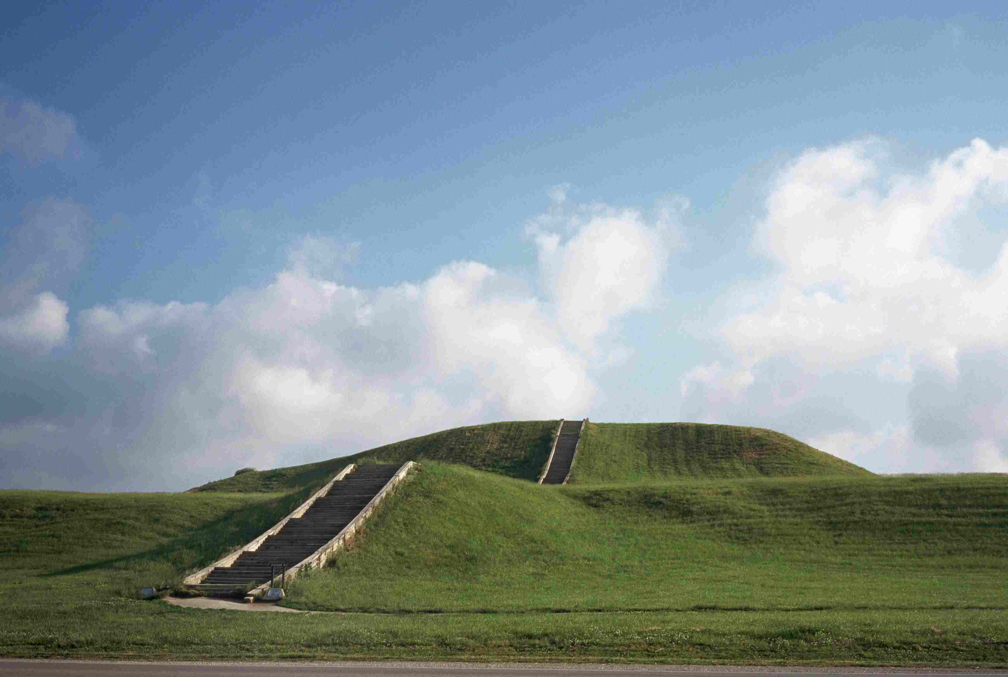 Cahokia Mounds against cloudy sky.