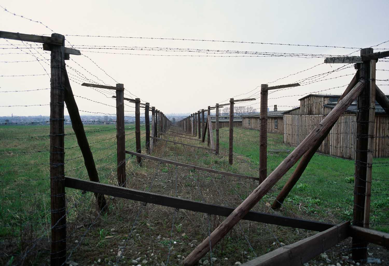 Barbed wire fence and barracks, Majdanek concentration camp, Poland