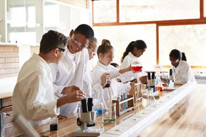 Students laughing while doing chemistry experiments