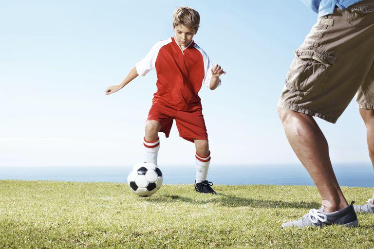 Boy feinting a pass in soccer