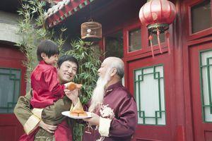 Chinese family sharing moon cake