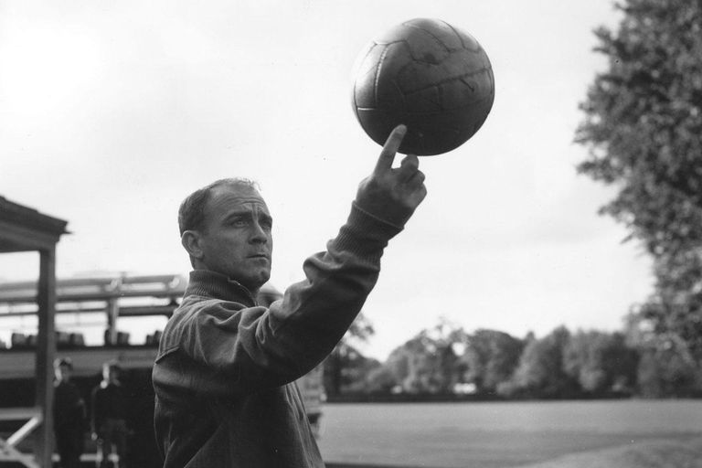 25th October 1960: Spanish footballer Alfredo di Stefano, one of the world's greatest forwards, spinning a ball on one finger during Spain's team practice at Roehampton in preparation for their match against England at Wembley.