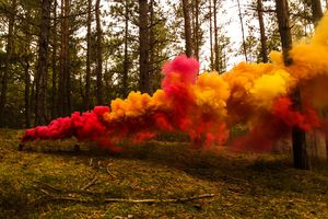 Colored smoke comes from vaporizing colored dyes