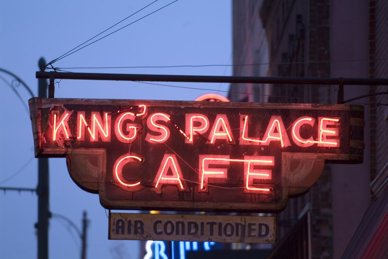 "neon sign reading ""King's Palace Cafe"""