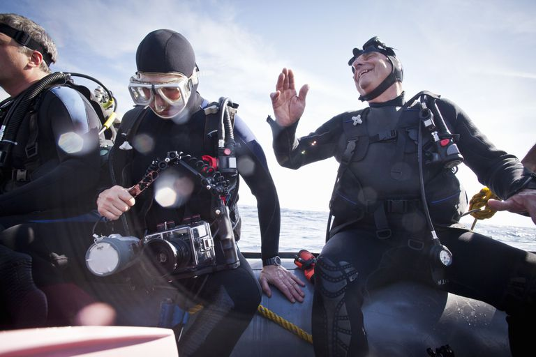 A diver laughing on a scuba boat