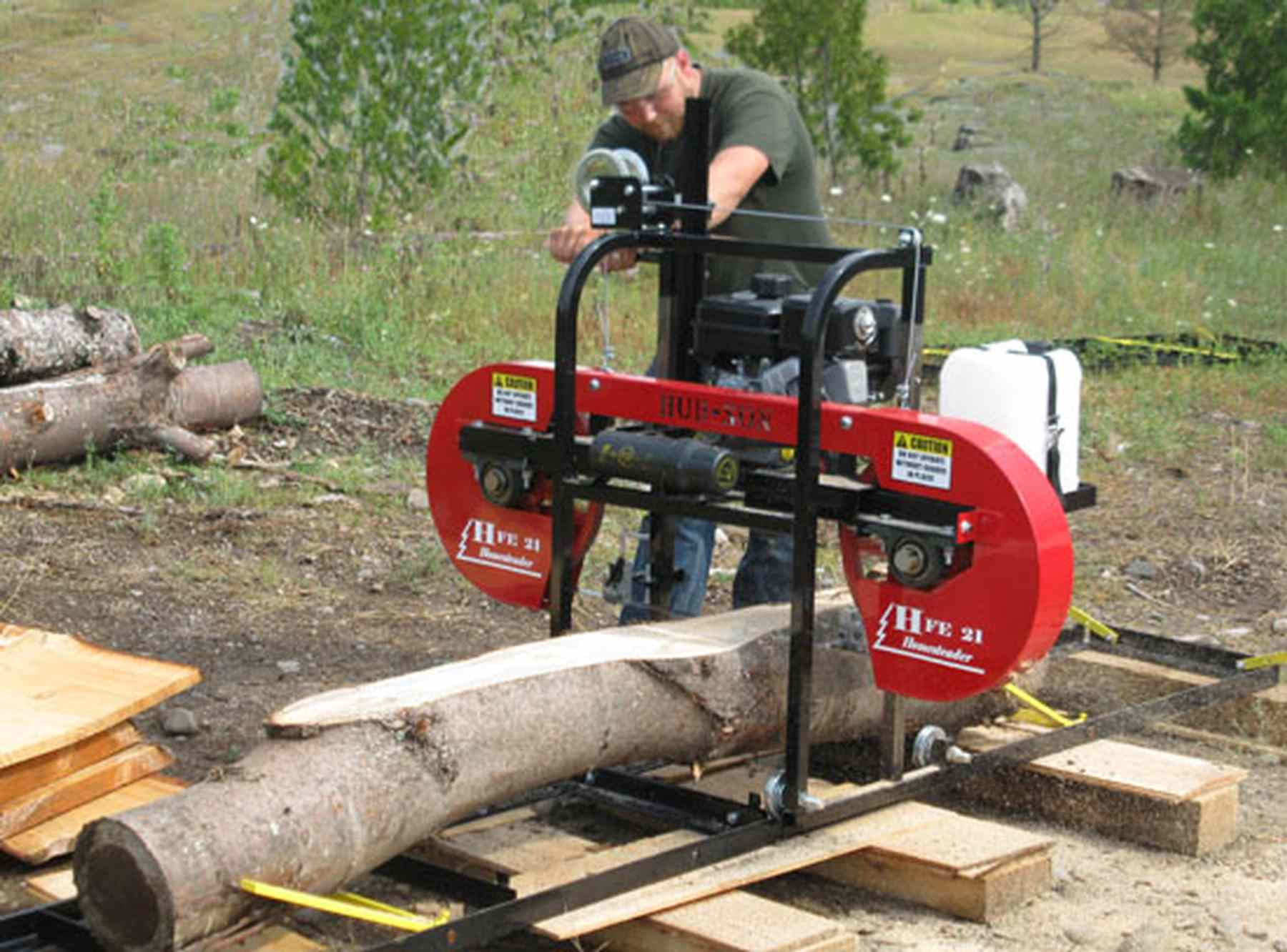 Man Working With A Portable Sawmill