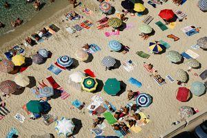 View of beach umbrellas in Tropea, Calabria, Italy