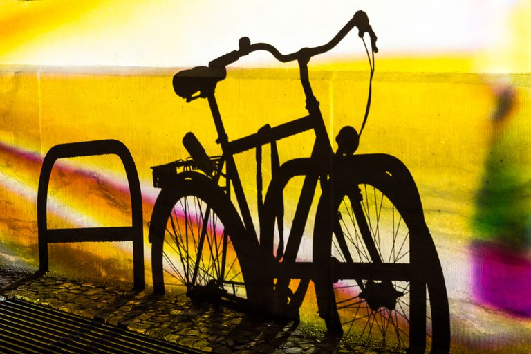Shadow-of-bicycle-locked-up