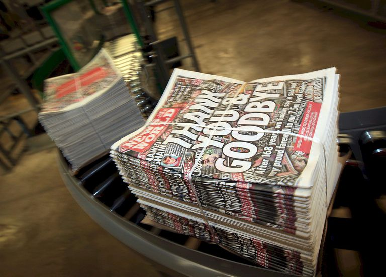 "Copies of the last-ever ""News of the World"" newspaper on a conveyor belt on July 9, 2011, in England."