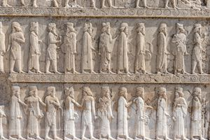 Stone relief depicting Syrians bearing tribute to Darius the Great of Persia