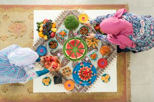Iranian Woman decorating table