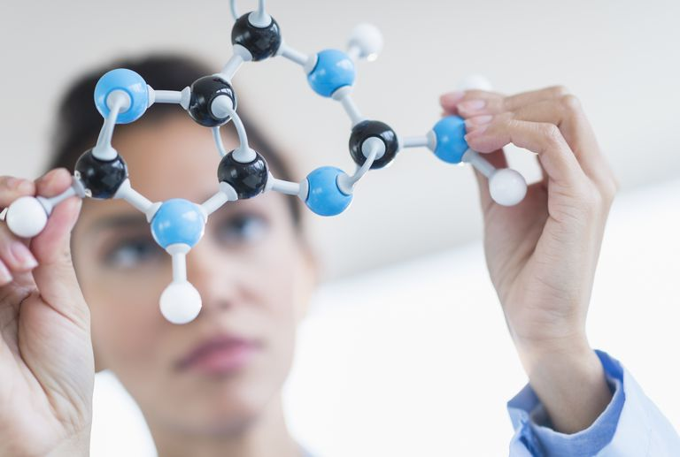 Woman holding a molecule model