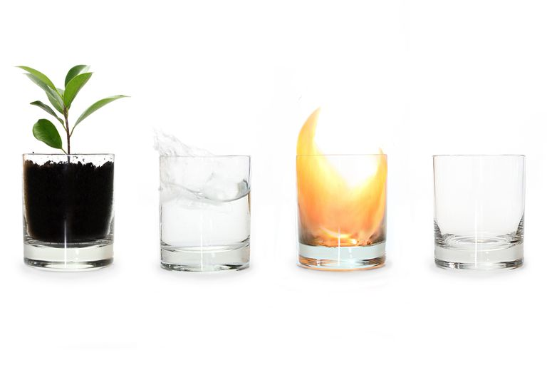 Four glasses holding each one of the four elements earth, air, fire, and water in that order.