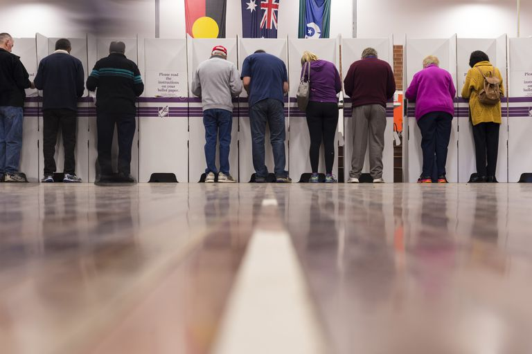 Australian voters casting ballots at voting polls