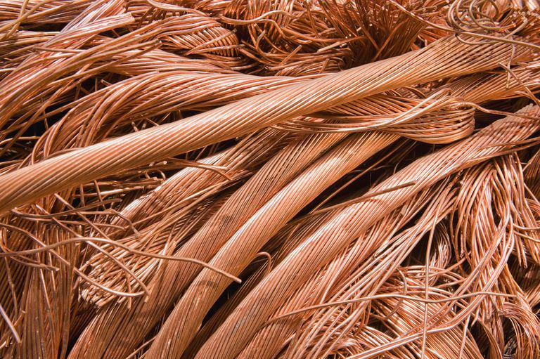 Close-up of thick copper wire strands laying in a pile.