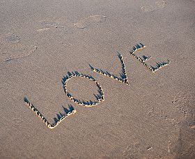 love word angel writing n beach