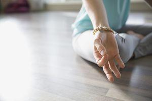 Close up of woman practicing mudra meditation