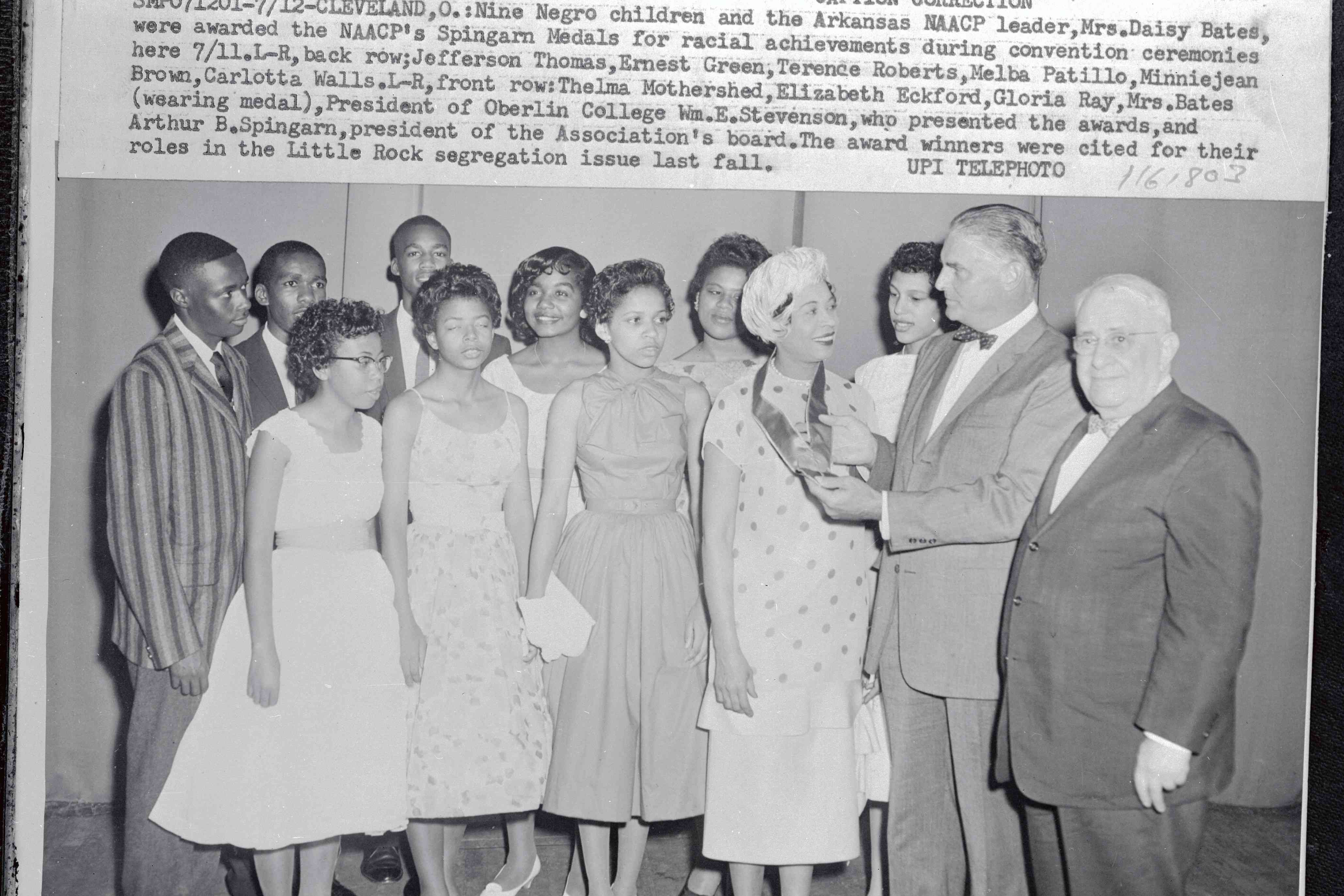Newspaper article showing Daisy Bates and Little Rock Nine being awarded the NAACP's 1958 Spingarn Medal