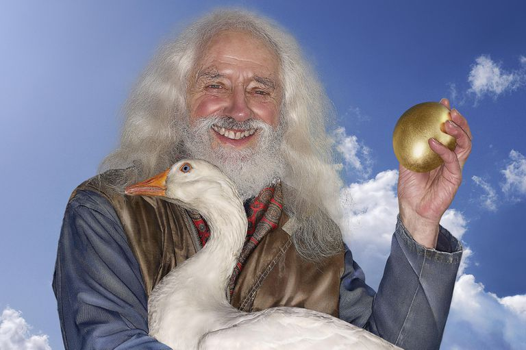 bearded man holding a golden goose and its egg