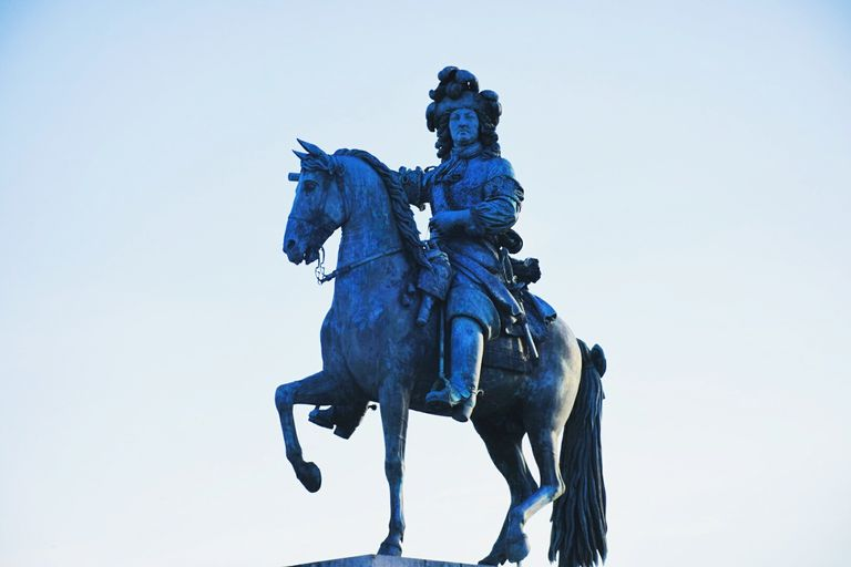 Low Angle View Of Louis Xiv Statue Against Clear Sky