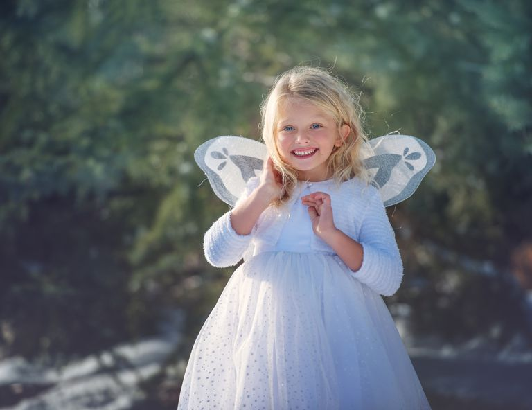 girl dressed in angel costume