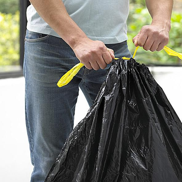 Man Tying a Garbage Bag