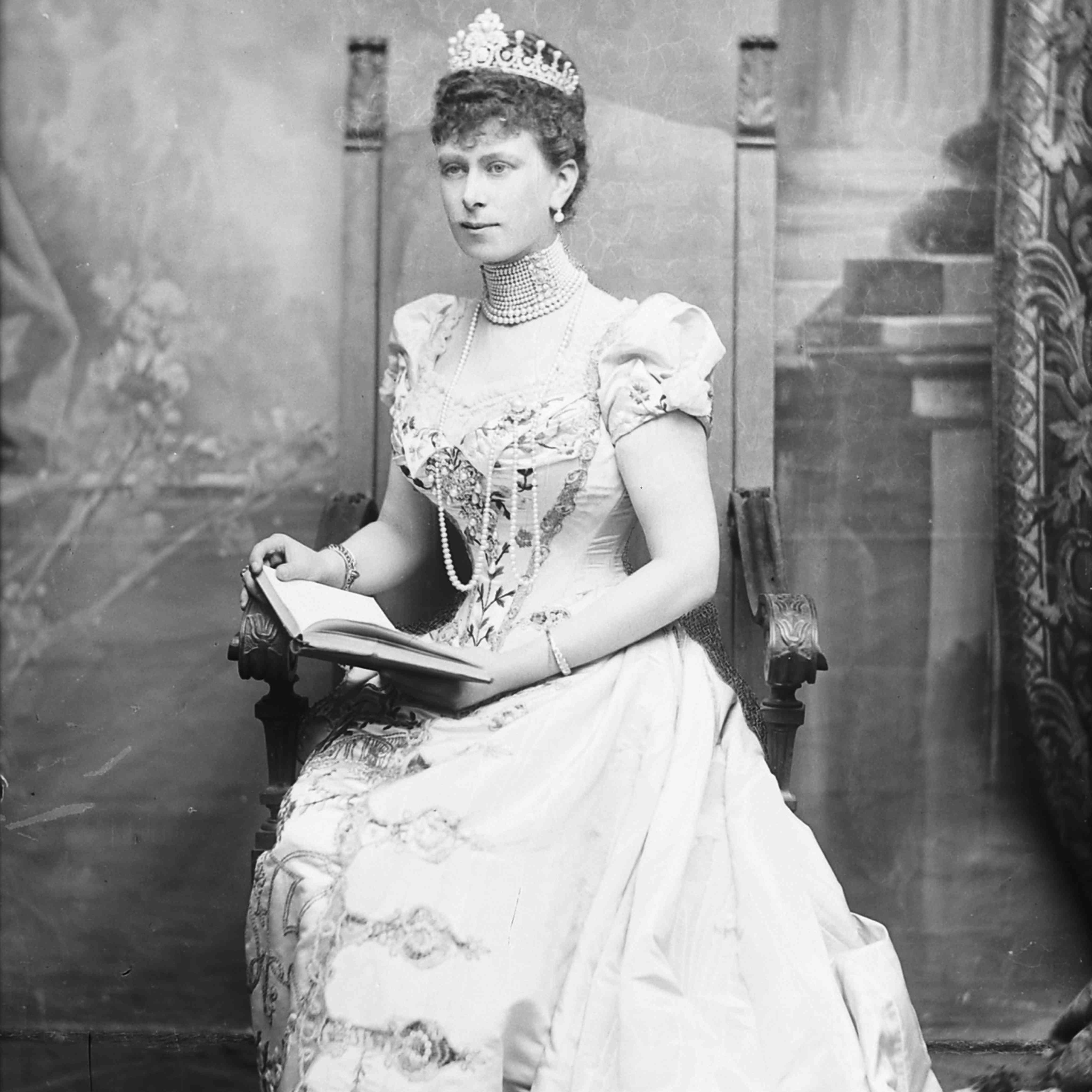 Princess Mary of Teck posing while reading a book