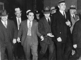 Lucky Luciano, gangster of sicilian mafia leaving the court in New York
