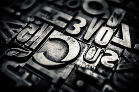 Different sizes of typographical pieces assembled in mosaic of letters