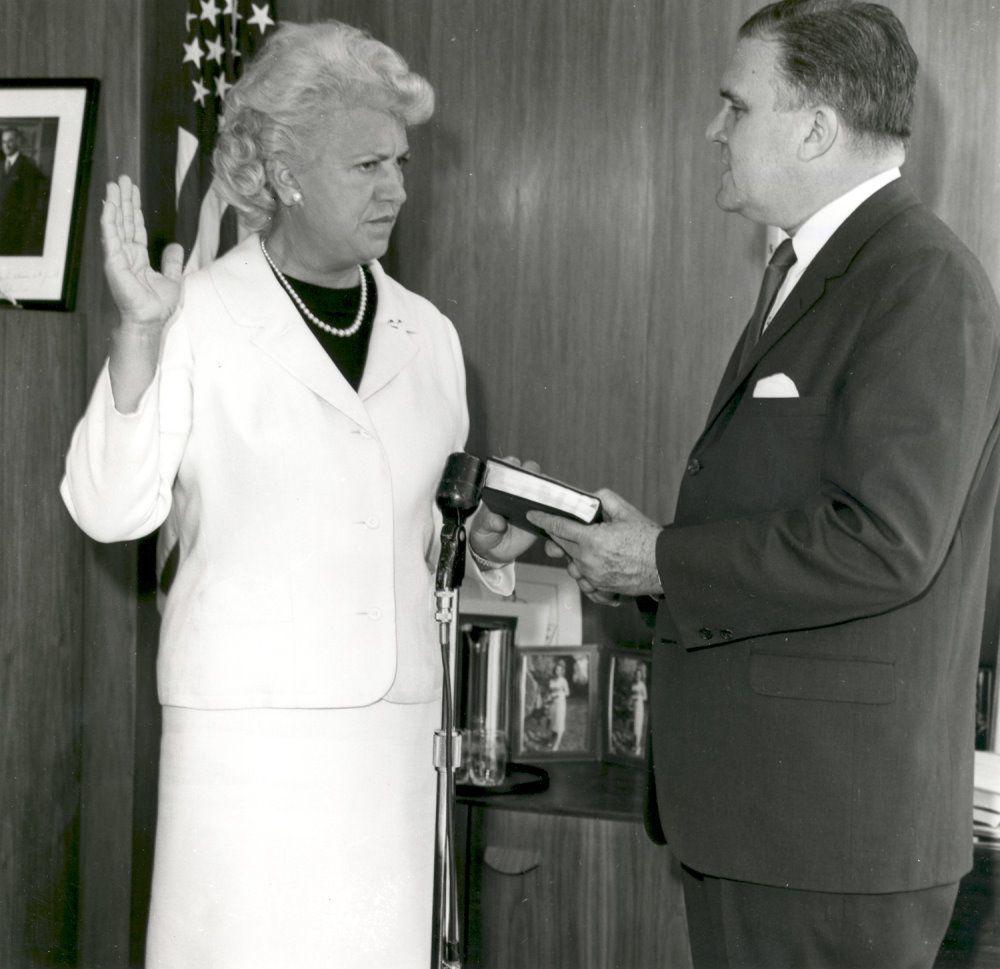 Jacqueline Cochran sworn in as NASA consultant by NASA administrator James E. Webb, 1961
