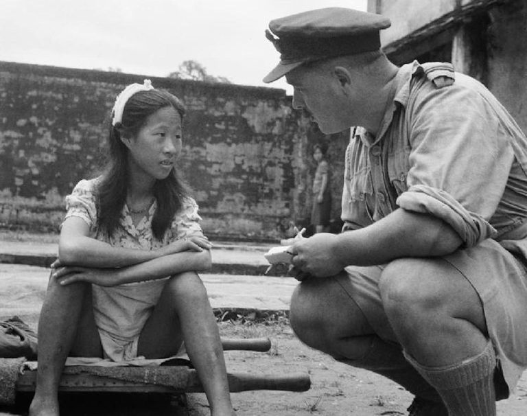 A young Chinese comfort woman being interviewed by an allied officer in Rangoon, Burma. August 8, 1945.