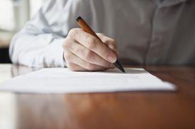 Man editing paper