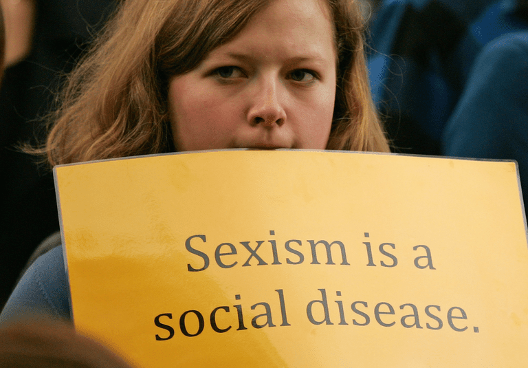 "Sign says ""sexism is a social disease"""