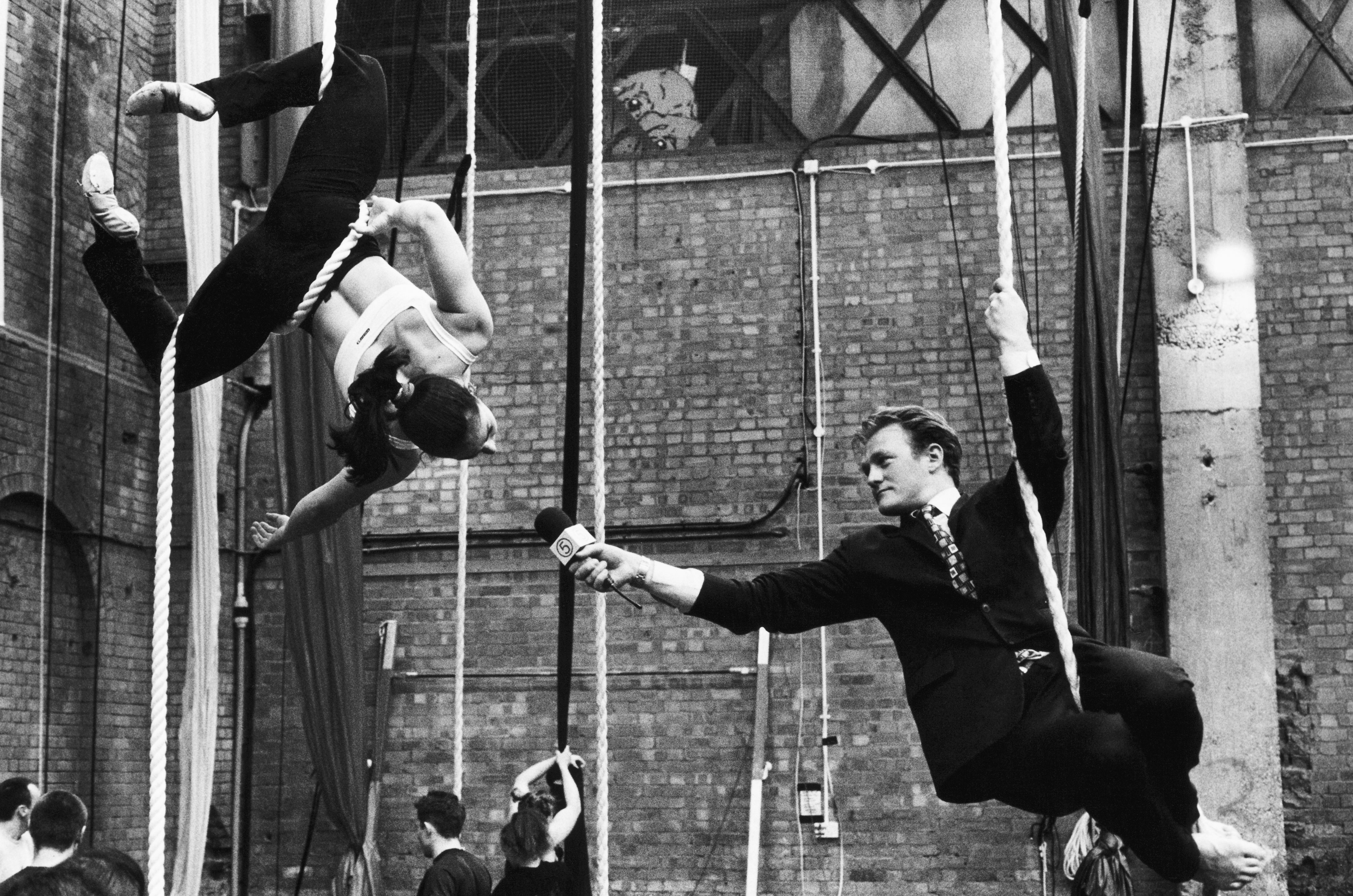 Journalist Interviewing an Aerial Acrobat at Rehearsal
