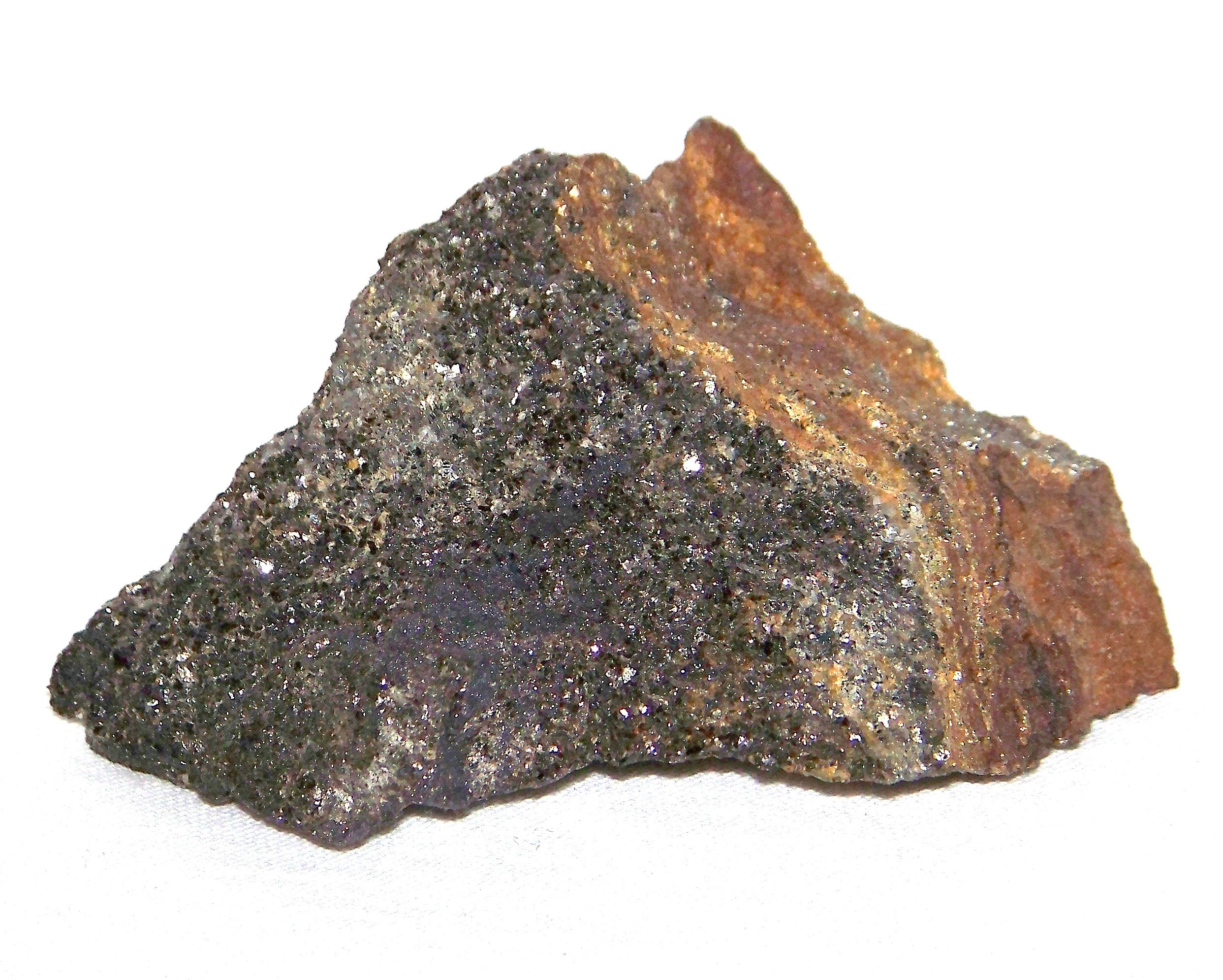 The surface of this hornfels specimen bears hydrothermal mineralization.