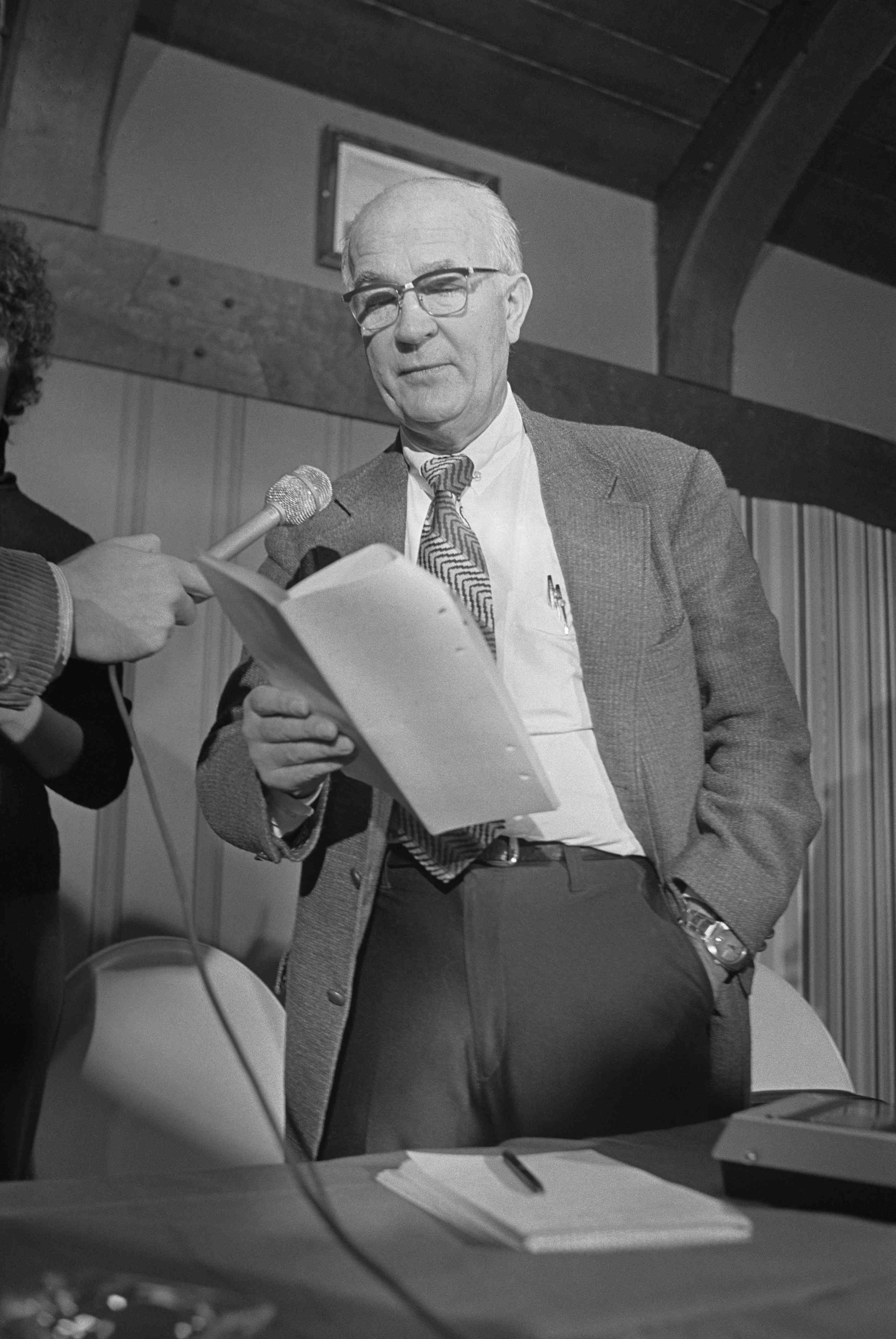 William Shockley Speaking to Newsmen with Notes in Hand