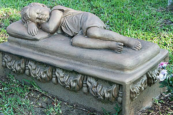 The sleeping child is one of the most common decorations on Victorian-era children's graves