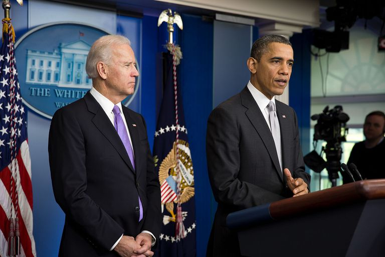 President Obama, with VP Joe Biden at podium delivering statement about gun control