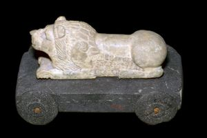Persian lion mounted on a wheeled carriage.