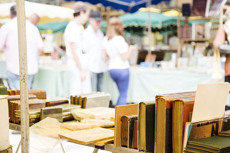 Market stall with old books on flea market in Aix-en-Provence, France