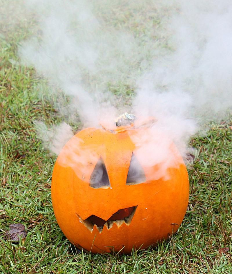 Here's what happens when you light a smoke bomb inside a Halloween jack-o-lantern.