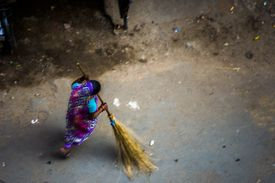 A woman street sweeper sweeping the filthy streets of Kolkata